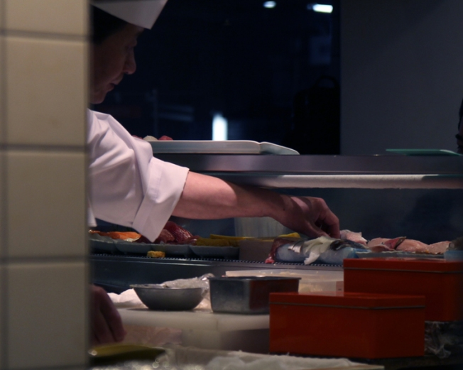 Chef preparing sushi at a restaurant in Itabashi.