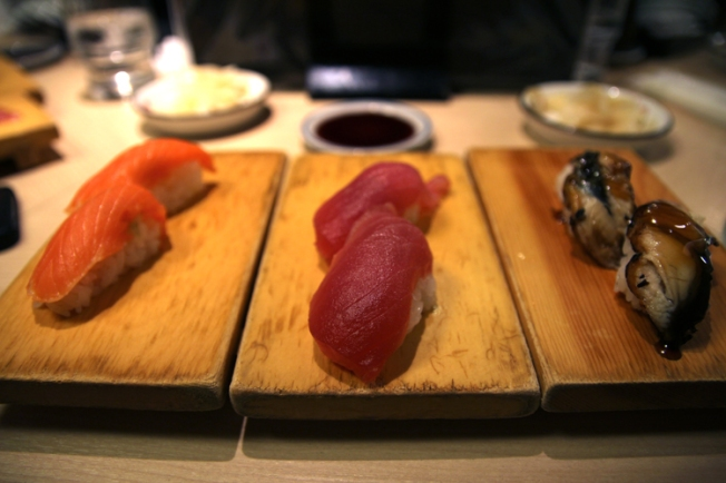 Sake, maguro and unagi nigiri - sushi pieces with salmon, tuna and eel at a restaurant in Itabashi.