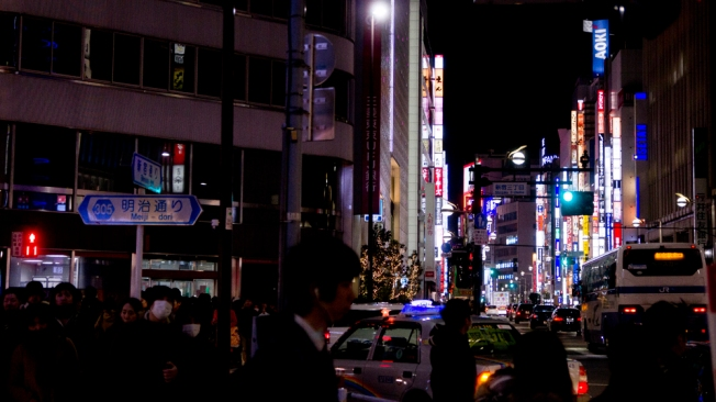 Street view of Shinjuku at night.