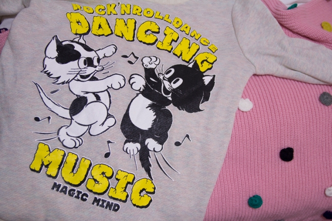 These were my exciting purchases of the day - adorable cats having a dance party and a pink sweater with knit dots that was on sale 50% and I thought was going to cost 1500 yen - but for some reason rang up as 425 yen. 'Twas a great surprise.