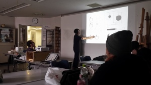Kaoru Sakurai teaches the intro students about using a grid in order to draw subjects with proper proportions.