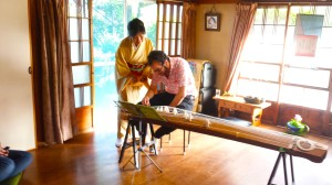 Joshua gives the Koto a try.