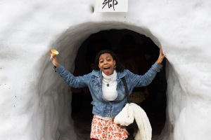 "Kay James, a TUJ student, admires a giant ice home. ""It's still cold!""  (I couldn't tell if she was talking about her ice cream, or the ice home...)"