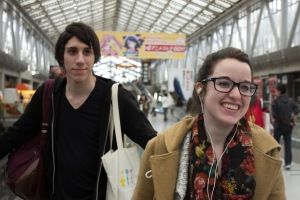 TUJ students Carlos Casademont and Megan Smith laughing over something but still having a good time enjoying Anime Japan and checking out all of the booths and merchandise.