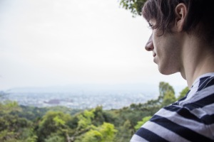TUJ student Carlos Casademont looks out over Kyoto from Fushimi Inari Shrine.