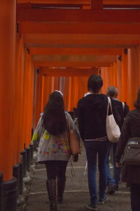 Temple Japan students Carlos Casademont and Megan Smith head up Fushimi Inari Shrine among the Torii gates.