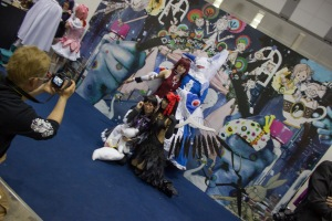 There was a large cosplay area where people could take photos of those dressed up. Here, they provided backdrops from specific shows, so that those characters could pose with it
