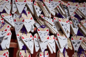 These woodblocks are available at multiple shrines all over Japan, but this shrine specifically in the shape of a fox, for the Inari-kami. These are for writing your wishes on, but lately it seems that they are a way to display your level of art.