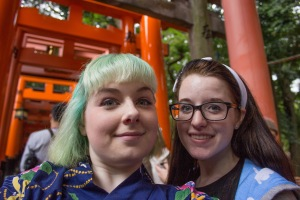 "My logic at an early morning hour said ""Wear my yukata and climb up to the top of Fushimi Inari Shrine. It'll be fine."" It wasn't fine. Here though, TUJ student Megan Smith and I snapped a photo with the Torii gates BEFORE we had made it to the top."