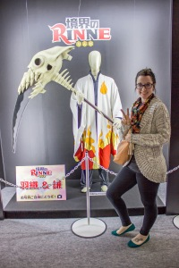 Here Temple Japan student Megan Smith poses with the outfit and prop for the titular character from the upcoming anime series Kyōkai no Rinne.