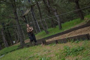 The next activity included an adventure course and zipline. TUJ Oona Murphy comes to a running halt down the zipline.