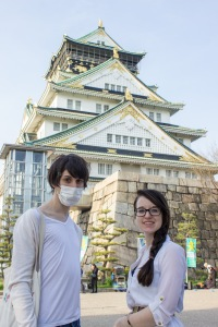 TUJ students Carlos Casademont and Megan Smith sotp for a photo outside of Osaka Castle in Osaka.