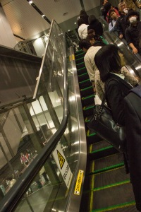 "One thing that makes Osaka different from Tokyo is that escalators ""flip"". In Tokyo, you stand on the left side of the elevator. As seen here, in Osaka, you stand on the right."
