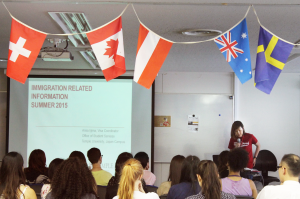 Arisa Iijima, Visa Coordinator from TUJ's Office of Student Services presenting immigration information during day 2 of orientation week. Held in Azabu Hall room 206 in Tokyo, Japan.