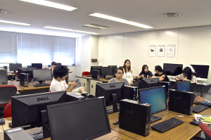 Students waiting to receive their TUJ student IDs in one of TUJ's computer labs located on the 3rd floor of Azabu Hall in Tokyo, Japan.