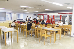Cafeteria located on the 2nd floor of TUJ's Azabu Hall in Tokyo, Japan. A common place for students to hangout equipped with vending machines serving various drinks and snacks.