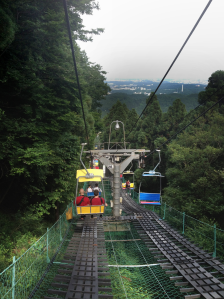 TUJ students riding the chairlift back down Mt. Takao towards the end of the trip.