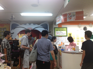 TUJ students lining up to pay for entry at Nekorobi, a neko (cat) cafe located in the department store Tokyu Hands on the 8th floor in Ikebukuro.