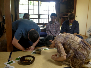 TUJ student and one of the Traditional Arts Workshop instructors formally bowing to each other after tea is served during the tea ceremony.