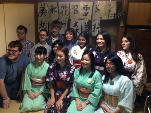 Group photo of TUJ students at the Traditional Arts workshop, wearing their yukatas and pins.