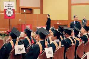 All graduates (BA, MBA, AA. MS.Ed, and LL.M) seated separately by degrees.