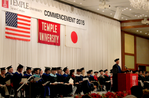Temple University Graduation Ceremony stage filled with staff and administrators.