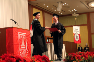 TUJ student receiving his diploma.