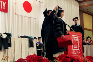 TUJ A.A. graduates were adorned with a special sash on stage after receiving their diploma.