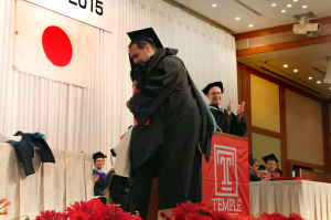TUJ A.A. graduate giving a heartwarming hug to his professor.