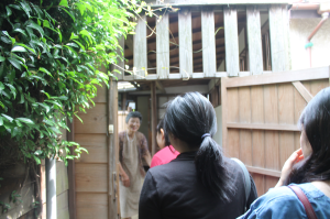 TUJ students entering a traditional Japanese home in Ogikubo, Tokyo Japan for the Traditional Arts Workshop.