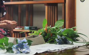 Ms. Akagi, sharing with TUJ students that she uses flowers freshly picked from her own garden to execute an ikebana.