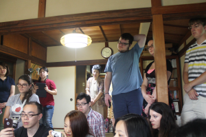 TUJ students focusing on the ikebana demonstration.