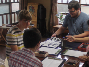 TUJ male students during their lesson of calligraphy.