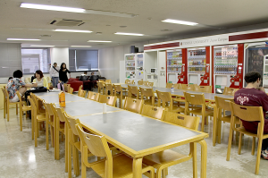 The TUJ Cafeteria located on the 2nd floor of Azabu Hall where students study, hangout, and can buy various snacks and drinks from the vending machine.