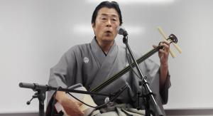 Shamisen musician and singer Nakamura Ichinosuke performing his songs