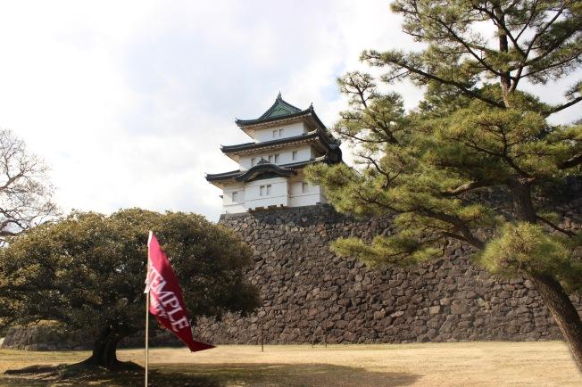 temple flag held